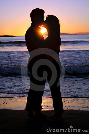 Free Silhouette Of A Young Couple Kissing At The Beach Stock Photos - 3828173