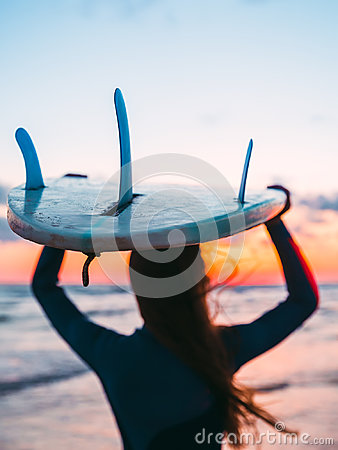 Free Silhouette Of Girl With Surfboard On Beach At Sunset Or Sunrise. Surfer And Ocean With Waves Royalty Free Stock Photos - 94920238