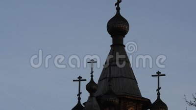 Silhouette of Ortodox temple on sunrise sky, Christian cross on top of church tower. 4K. Silhouette of Ortodox temple on sunrise sky, Christian cross on top of stock footage