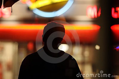 Silhouette over neon lights