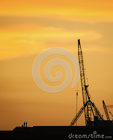 Silhouette people discussing at construction site in the dawn