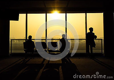 Silhouette of people waiting for departure from airport
