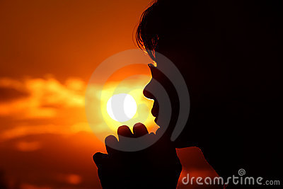 Silhouette of person in profile against background