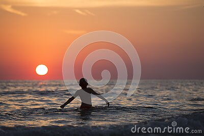 Silhouette Photo Of Child On Body Of Water During Golden Hour Free Public Domain Cc0 Image