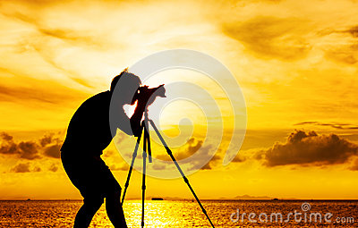 Silhouette of photographer with tripod