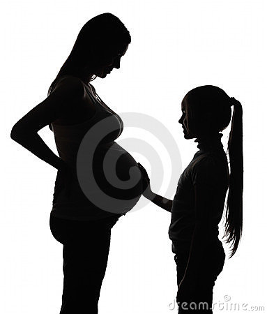 Silhouette of the pregnant woman with daughter