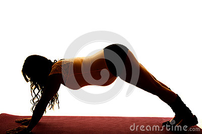 Silhouette of a pregnant woman exercise on hands an feet face do
