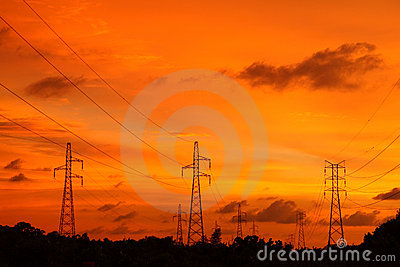 Silhouette pylons against sunset twilight zone