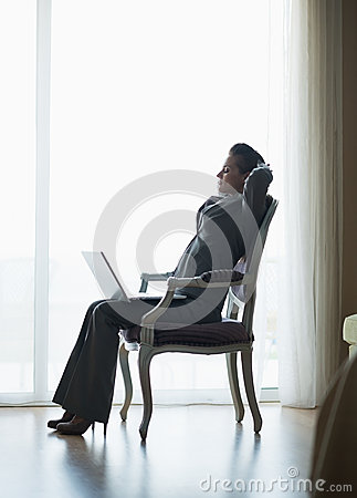 Silhouette of relaxed business woman in hotel room