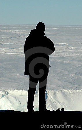 Silhouette of researcher in front of Antarctica