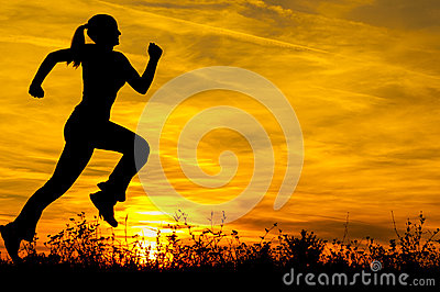Silhouette of the running girl at sunrise
