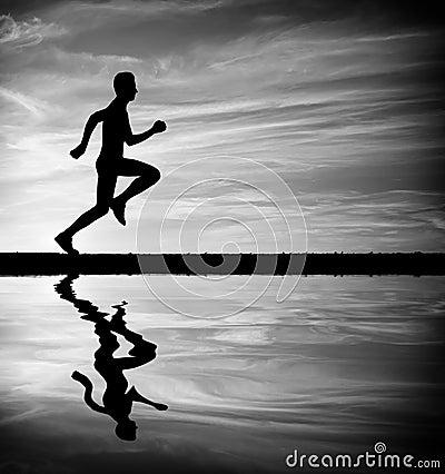 Silhouette of running man against sky.