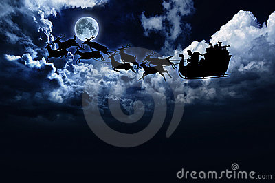 Silhouette of santa sleigh & reindeer in night sky