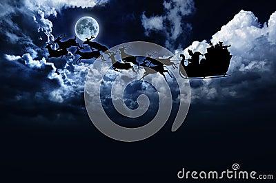 Silhouette of santa sleigh & reindeer in night sky