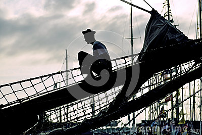 Silhouette of the seaman on the yacht