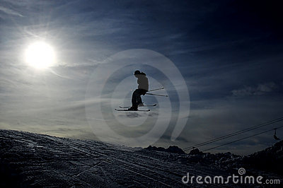 Silhouette of skier jumping