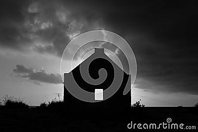 Silhouette of slave hut