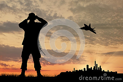 Silhouette of a soldier and an airplane Stock Photo