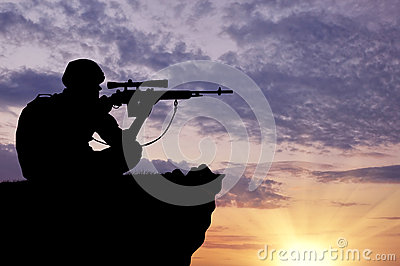 Silhouette of a soldier sniper Stock Photo