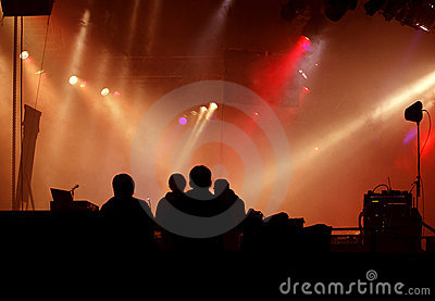 Silhouette of stage-crew and concert light