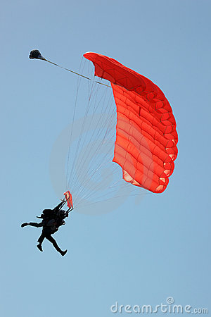 Silhouette of Tandem Sky Divers Landing