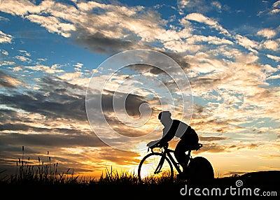 Silhouette of a triathlete in sundown