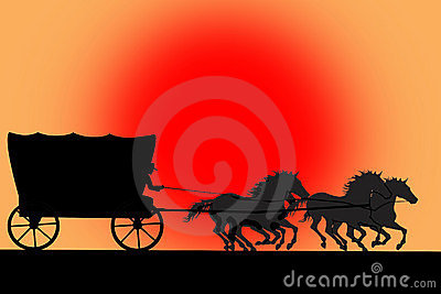 Silhouette of van with horses and cowboy