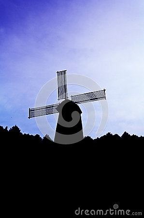 Silhouette Wind generator on colorful sky