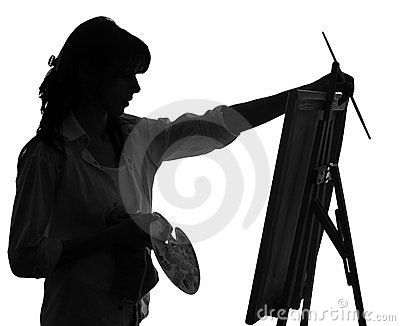 Silhouette of woman artist painting