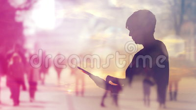 Silhouette of Woman Browsing Internet on Digital Tablet Computer, Double Exposure Footage. With Urban Street Crowd in Background, 1920x1080 full HD footage stock video