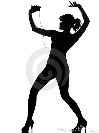 Silhouette woman dancing and listening music