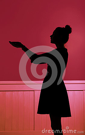 Silhouette of woman extending the hands