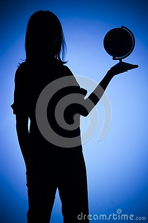 Silhouette of woman with globe