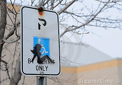 Silhouette of woman on handicap parking sign