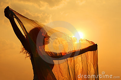 Silhouette of woman with transparent cloth