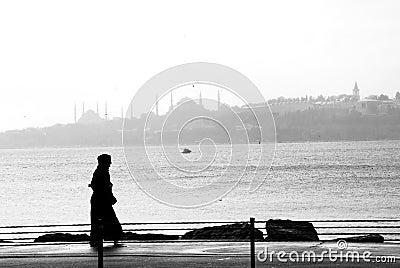 Silhouette of a woman walking