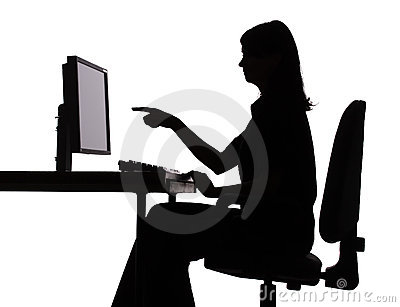 Silhouette of woman working computer - pointing screen