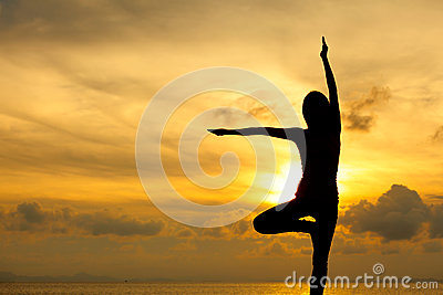 Silhouette of a woman yoga