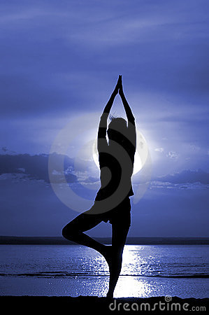 Silhouette of the women meditate