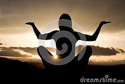 Silhouette yoga sitting