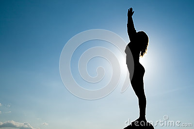 Silhouette of Yoga at summit