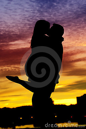 Silhouette of a Young Couple by the water