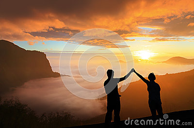 Silhouette of Young family happy look sunrise
