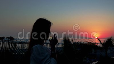 silhouette young girl glass wine sunset background beach k beautiful girl sea sunset drinks 104112958