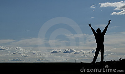 Silhouette of a young happy man