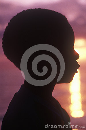 Silhouette of young Jamaican at sunset Editorial Stock Image