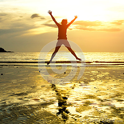 Silhouette of young jumping girl