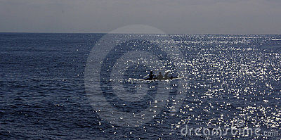 Silhouetted canoe in sea