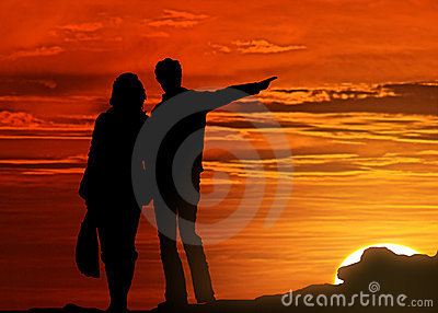 Silhouetted couple at sunset