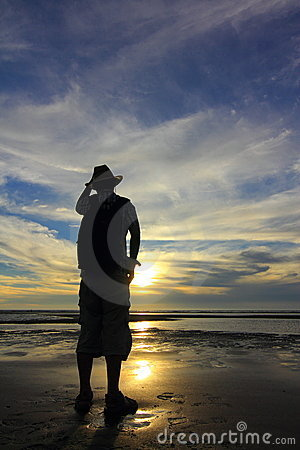 Silhouetted man on beach